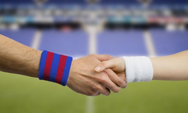 Close Up Handshake Of Football Players